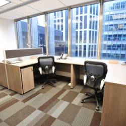 Office area of business center. Multiple workstations. Office furniture provided. Central air-conditioning. Abundant natural light. (Wheelock House)