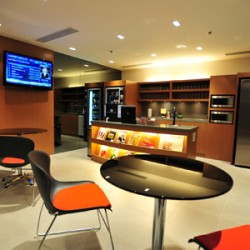 Lounge area. Modern design with chic office furniture. Equipped with a TV, fridge and magazine stand. (The Center)