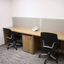 A room of double workstations. Office furniture including cabinet provided. (Miramar Tower)