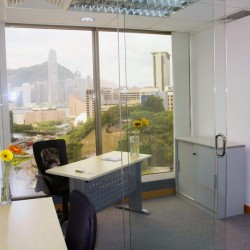 A room of single workstation. Open view with natural sunlight. Office furniture provided with cabinet. (Wing On Plaza)