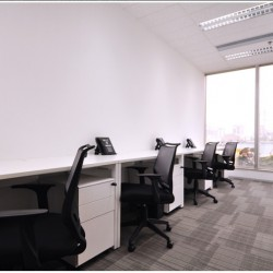 A room of multiple workstations. Office furniture including cabinet provided. (Sino Plaza)