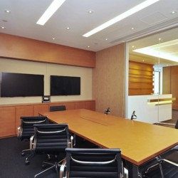 Conference room of business center. Equipped with two TVs and a white board. Central air-conditioning. (Sino Plaza)