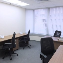A room of multiple workstations. Open view with sufficient sunlight. Office furniture including cabinet provided. (Kowloon Building)
