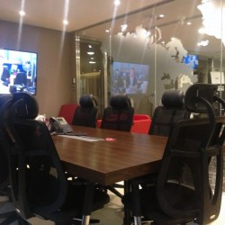 Conference room of business center. Equipped with a TV and teleconference facilities. (The Sun's Group Centre)