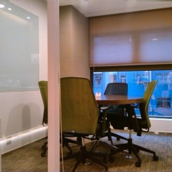 Conference room of business center. Office furniture including cabinet and whiteboard provided. (The Sun's Group Centre)
