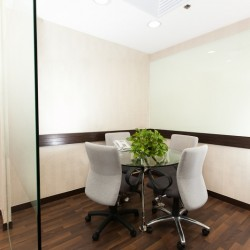 Meeting room of business center. Office furniture including a projector provided. (New World Tower 1)