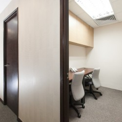 A room with double workstations. Office furniture including cabinet provided. Central air-conditioning. (New World Tower 1)