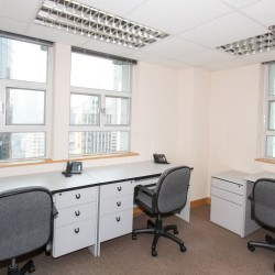 A room of multiple workstations. Office furniture including cabinet provided. Abundant natural light. (Mongkok Commercial Centre)