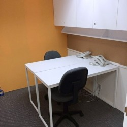 A room of double workstations. Office furniture including cabinet provided. (Hung To Centre)