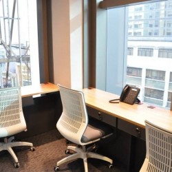 Multiple workstations of business center. Open city view with sufficient natural light. (Central 88)