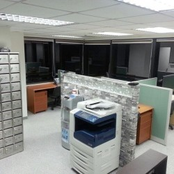 Office equipment: photocopier and cabinet.