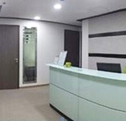 Reception of business center. Equipped with a water dispenser, photocopier and sofa. Multiple rooms of business center. (Silver Fortune Plaza)