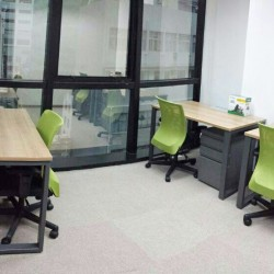 Room of multiple workstations. Office furniture including cabinet provided. Abundant natural light. (Silver Fortune Plaza)