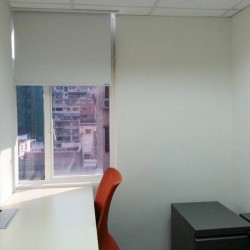 Single workstation. Office furniture including cabinet provided. Abundant sunlight with open view. (Astoria Building)