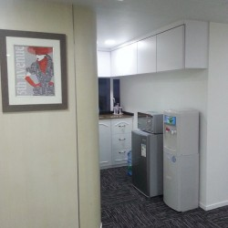 Pantry of business center. Equipped with a fridge, microwave oven, cabinet and water dispenser. (Astoria Building)