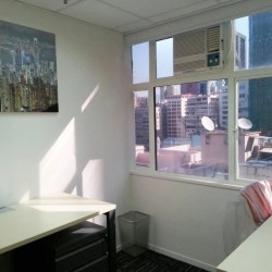 Room of multiple workstations. Office furniture including cabinet provided. Abundant natural light. (Astoria Building)