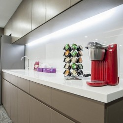 39A04_Pantry of business center. Modern design with office furniture provided. Equipped with a fridge and coffeemaker.