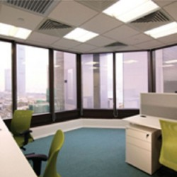 41A08_A room of multiple workstations. Open view with abundant natural light.