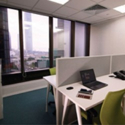 41A09_A room of multiple workstations. Open view with abundant natural light.