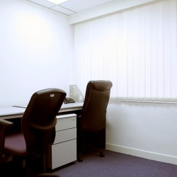 Room of business center. Double workstations. Office furniture provided. Abundant natural light. (Eastern Commercial Centre)