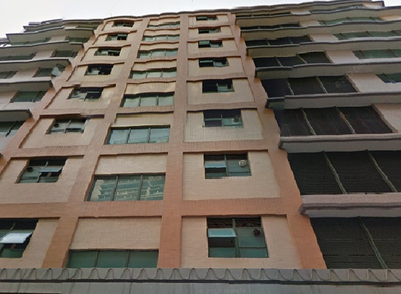 The facade of Hung To Centre. Located on How Ming Street, Kwun Tung. 9-storey.